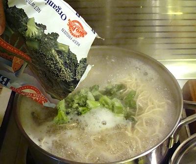 adding frozen vegetables