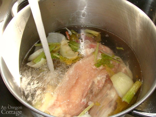 traditional chicken stock-adding water to pot