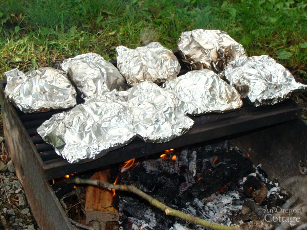 Cooking Chicken Foil Dinner packets at campsite
