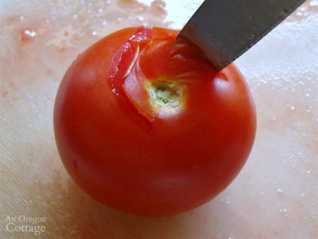 How to peel tomatoes easily-coring a tomato with a knife