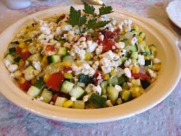 Zucchini, corn, and tomato saute