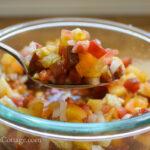 fresh tomato bruschetta on spoon