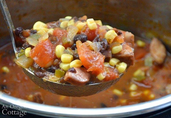 Black Bean Sausage Soup on ladle