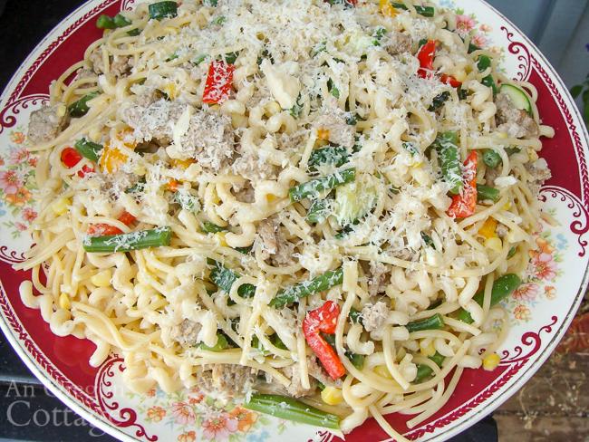 Italian sausage pasta primavera on platter
