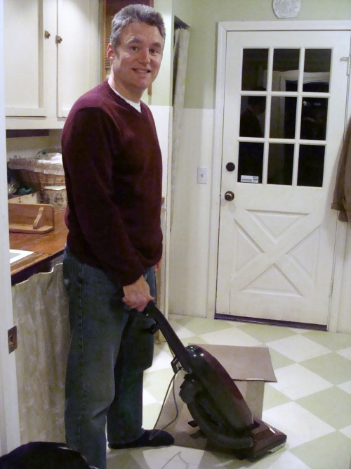 Vacuuming on family cleaning night