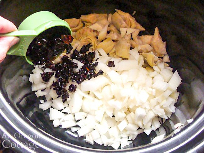 adding ingredients to slow cooker bowl