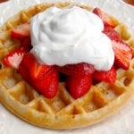 Fluffy Sourdough Waffles with strawberries and whipped cream