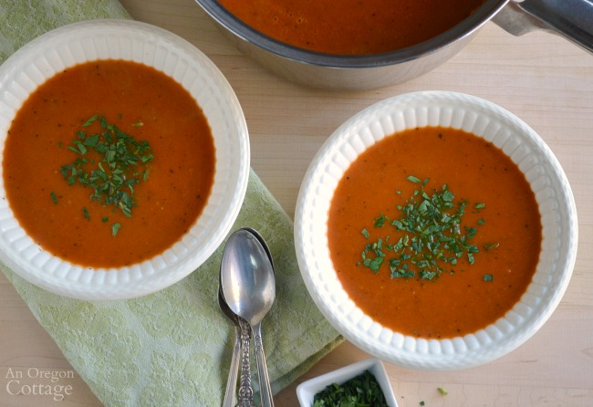 Tomato soup in bowls with soup pot