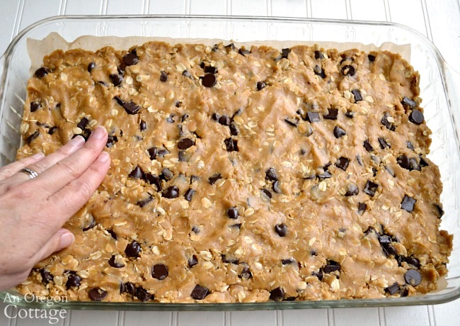 Whole Grain Chocolate Chip Peanut Butter Bars-pressing dough
