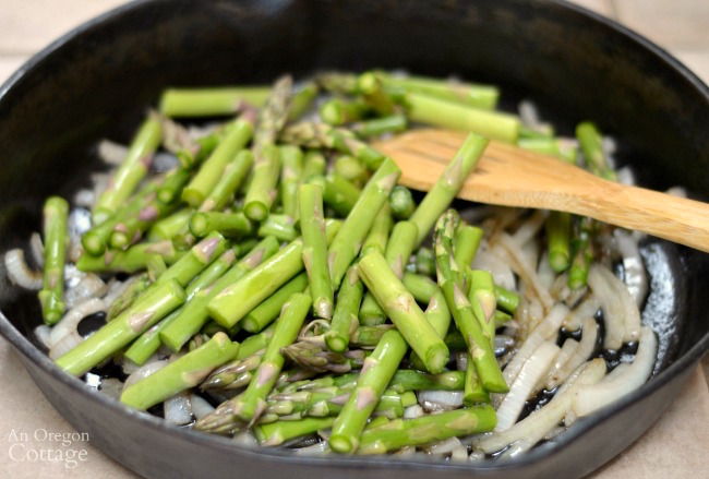 Cooking asparagus and onion for Shrimp and Asparagus over White Bean Puree