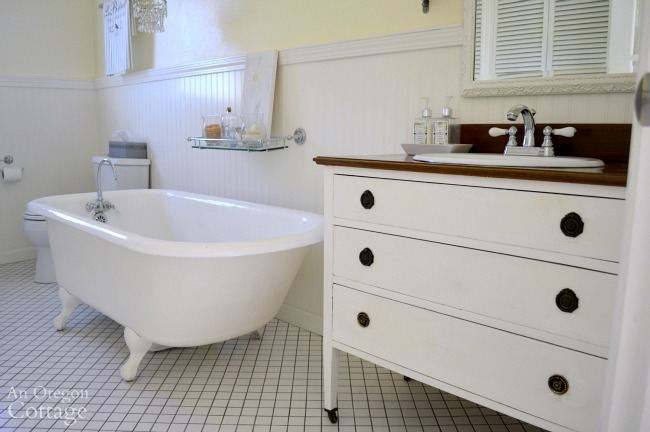 Dresser vanity with clawfoot tub