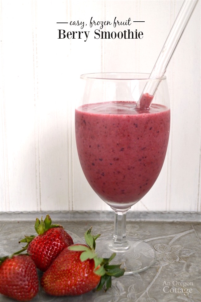 berry smoothie made with frozen fruit in glass