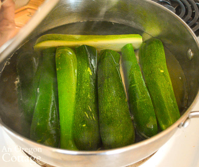 steaming zucchini in pot