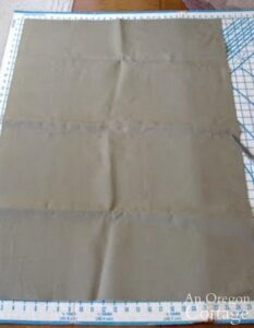 Cut canvas for log carrier