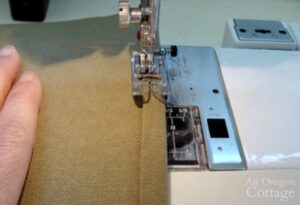 sewing side seams of canvas log carrier