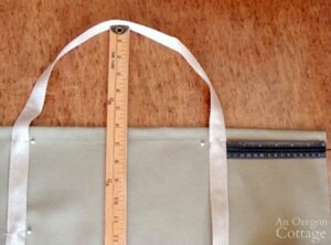 measure handle for canvas log carrier