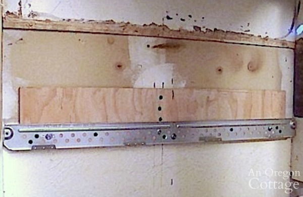 mounting bracket for retrofit cabinet for microwave
