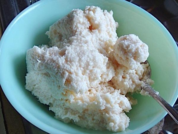Mini Almond Joy Brownies-stirring coconut mixture