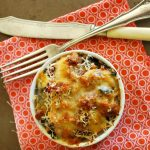 An easy gratin (aka, casserole) made with sausage, bean, greens, and topped with cheese is healthy, inexpensive, and delicious real food recipe.