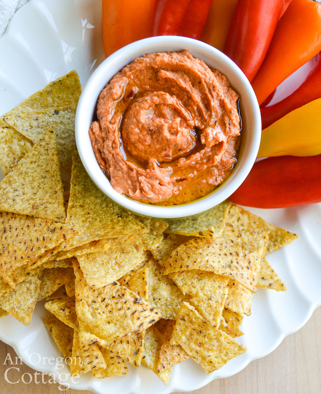 white bean dried tomato dip above with chips and crackers