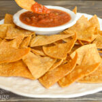 homemade tortilla chips on plate with salsa