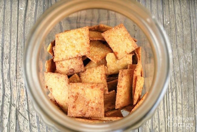 Whole Wheat Cheese Sriracha Crackers top of jar