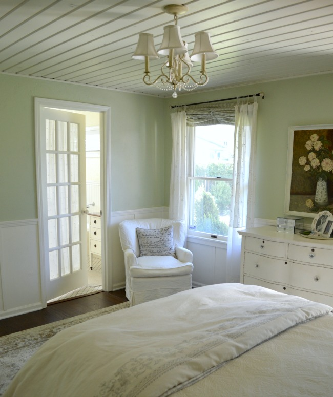 Green-White Master Bedroom with French door to bathroom