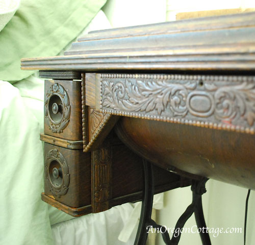 carving on drawers of antique machine