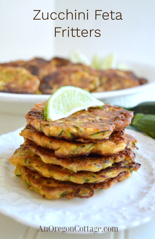zucchini feta fritters stacked on plate