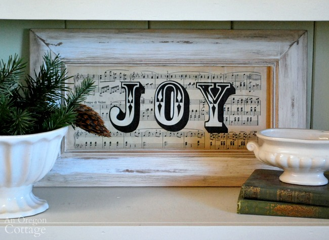 Vintage decoupaged sheet music JOY Christmas sign-upcycled from a door.