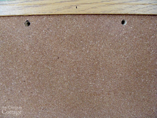 holes drilled in corkboard