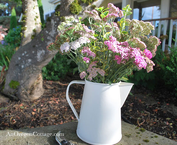 white tin pitcher with flowers