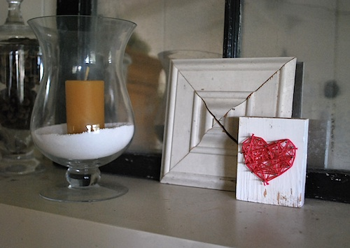 Nail-and-floss heart on mantel
