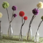pom flowers in bottles