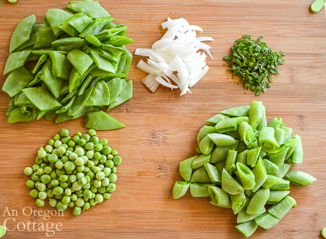 fresh pea salad ingredients on cutting board
