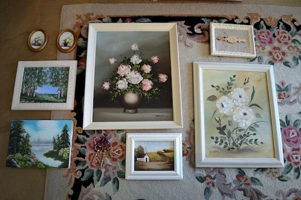 Arranging paintings on floor