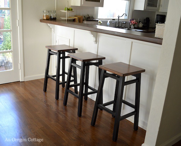 Black Painted and Wood-Stained Bar Stools at the Breakfast Bar at An Oregon Cottage