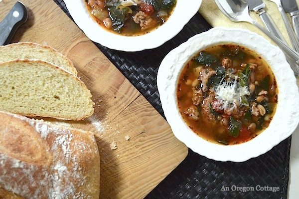 Slow Cooker Sausage-Bean Soup with Tomatoes & Spinach- SO good with a loaf of crusty bread!