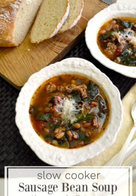 slow cooker sausage bean soup with spinach and tomatoes in bowls