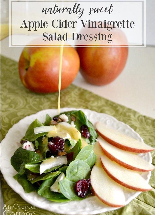 Apple cider vinaigrette dressing pouring onto salad