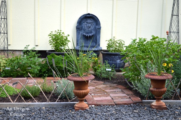 DIY Aged Plastic Fountain in Herb Garden - An Oregon Cottage
