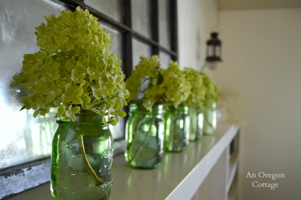 Summer Little Lime Hydrangea blossoms on a Mantel