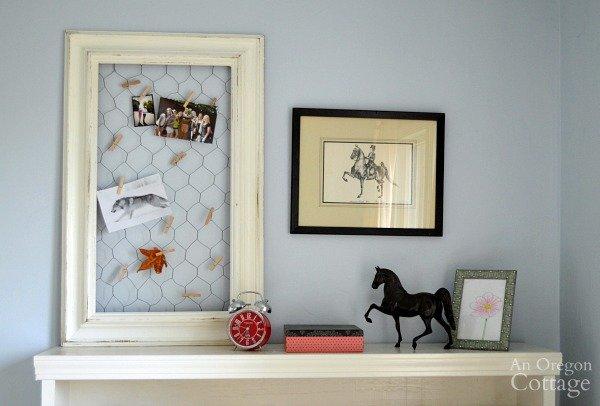 DIY chicken wire photo holder in bedroom