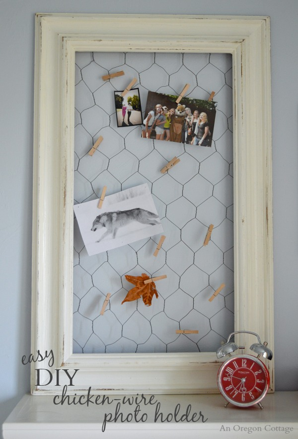 Easy diy chicken wire photo holder from a thrifted frame for Chicken wire craft ideas