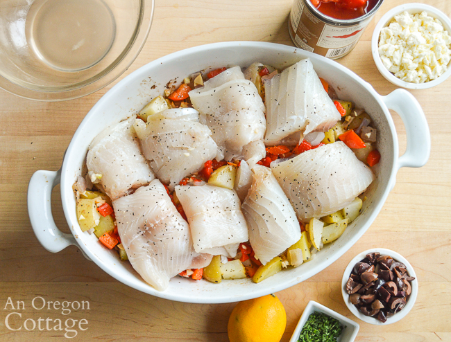 Adding fish to Mediterranean Fish Bake