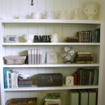 Living Room Shelves - Industrial Accents - vintage toolbox, fan, and books