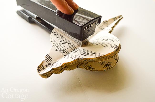 stapling music sheet ornament