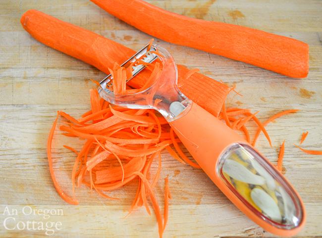 Grating Sriracha Chicken Noodle Bowl carrots