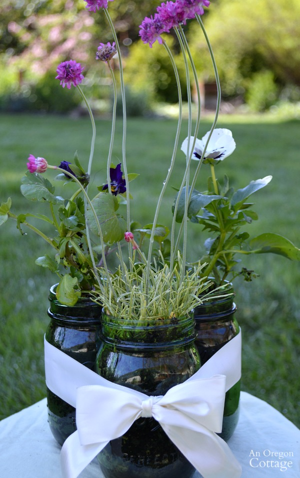 Easy mason jar-ribbon centerpiece filled with live plants