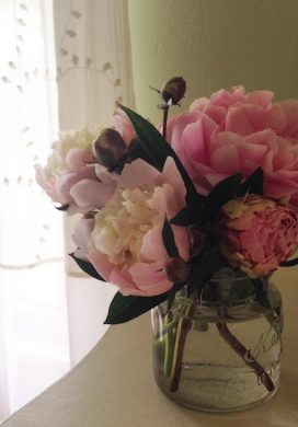 Peonies in a mason jar vase